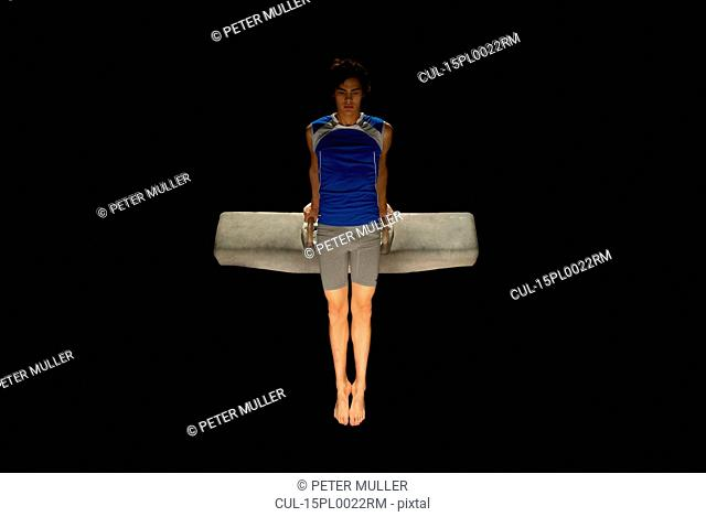 gymnast on pommel horse holding pose
