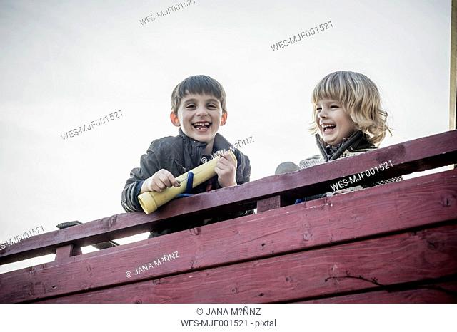 Two little boys having fun on a playground