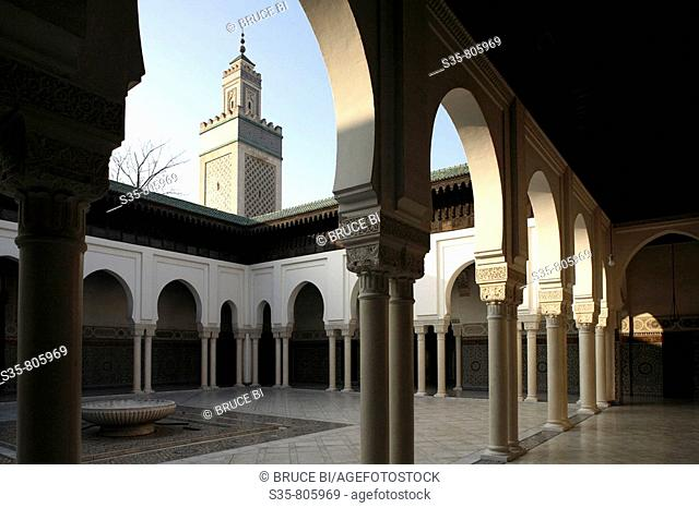 Courtyard of the Great Mosque of Paris with minaret in background, Paris. France