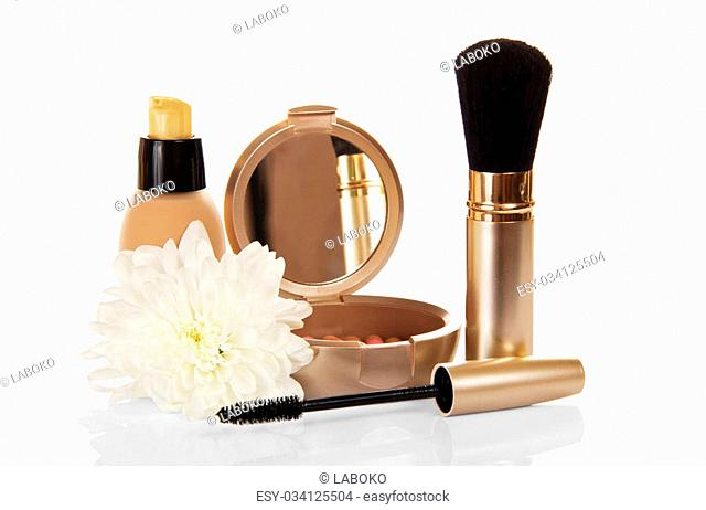 The basis for cosmetics, the blush, mascara and the chrysanthemum flower, isolated on white