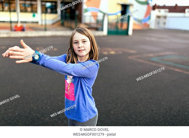 Portrait of a girl playing on the street