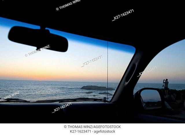 Man photographing sunset