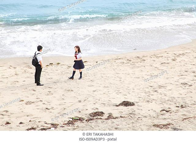 Young couple on sandy beach