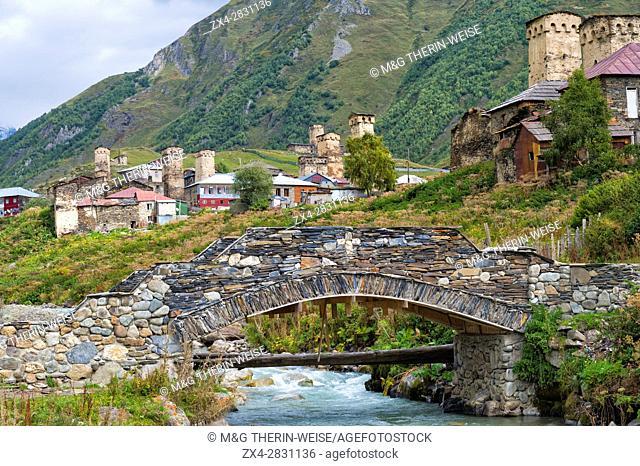 Traditional medieval Svanetian tower houses, Stone bridge over Patara Enguri River, Ushguli village, Svaneti region, Georgia, Caucasus, Middle East, Asia