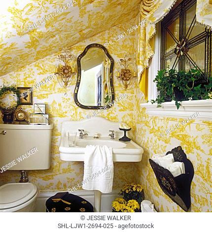 BATHROOMS: Under stairs room, French style, upholstered pale yellow and white toile scene, white vintage pedestal sink, crystal and glass sconces, swag valance