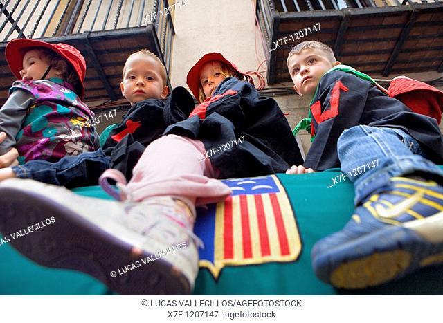 Children riding the`Guita Grossa' La Patum Masterpiece of Oral and Intangible Heritage by UNESCO Berga  Barcelona  Catalonia  Spain