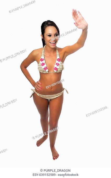 attractive young woman in a bikini just having fun