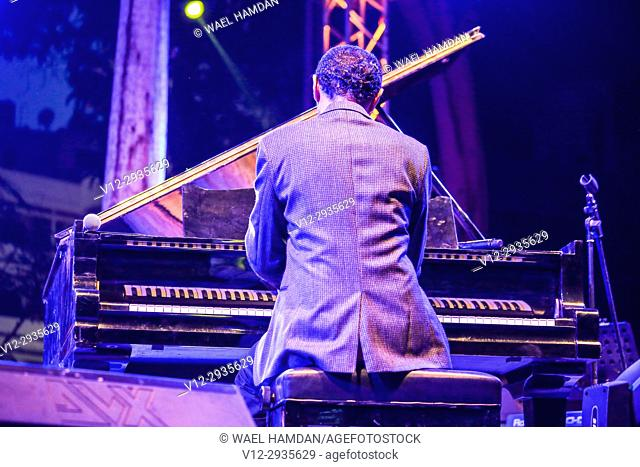 Musician playing piano on stage