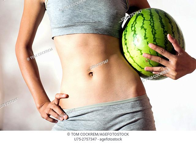 Slim woman with melon