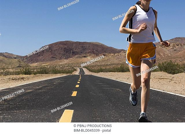 Mixed Race female runner on road