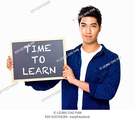 Asian mixed Indian man with blackboard showing the phrases of time to learn