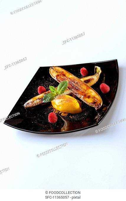 A fried banana with passion fruit sorbet and raspberries