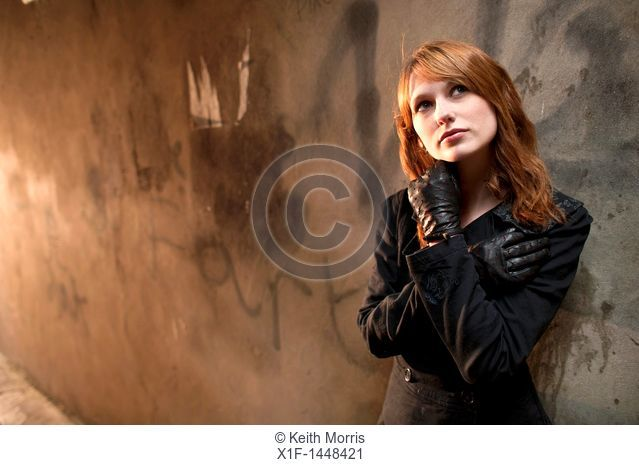 A late teen early 20s single woman girl with red hair, UK