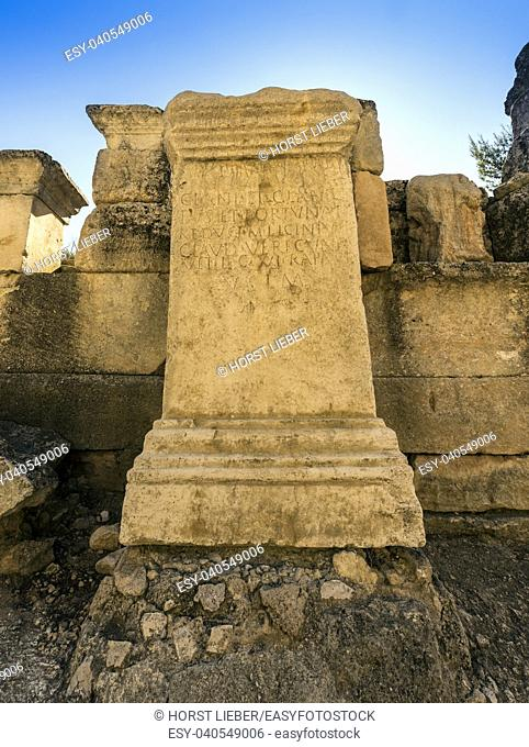 Stone with Roman inscription in Glanum. Saint Remy de Provence, Bouches du Rhone, Provence, France