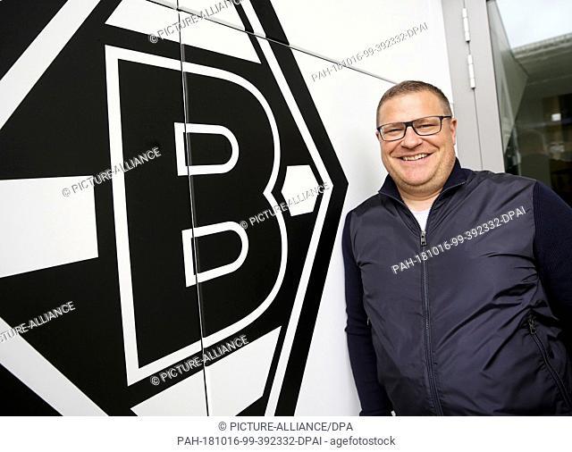 02 October 2018, North Rhine-Westphalia, Moenchengladbach: Max Eberl, sports director at Borussia Mönchengladbach, stands next to the newly added club logo