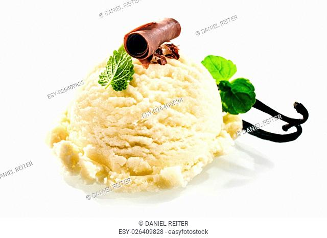 One scoop of creamy vanilla gelato decorated with green peppermint leaves and topped with chocolate shavings