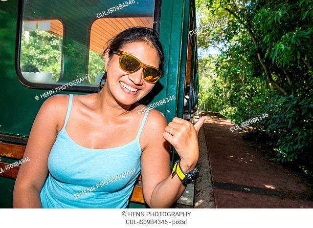 Woman riding the train to Iguazu falls, Misiones, Argentina