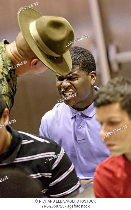 US Marine Corps Drill Instructors direct newly arrived recruits through receiving at Marine Corps Recruit Depot Parris Island to begin 13 weeks of boot camp...