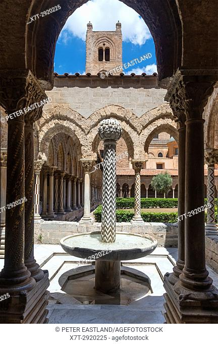 Decorated columns and fountain in The Chiostro dei Benedettini, cloisters, in the cathedral complex at Monreale near Palermo, Sicily, Italy