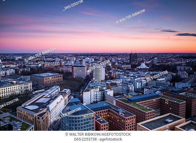 Germany, Berlin, Mitte, Panorama Punkt-Potsdamer Platz, elevated city view towards Kreuzberg district, dusk