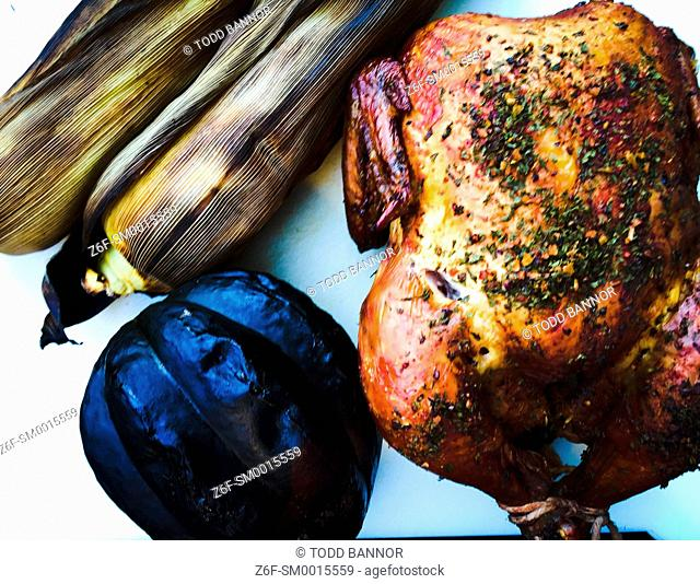 Smoke-roasted whole chicken, acorn squash and corn on the cob
