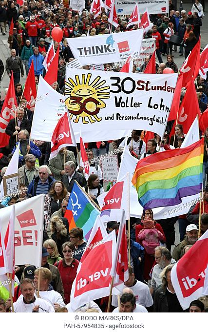 People rally with flags and banners during a demonstration organized by the Confederation of German Trade Unions (DGB) on May Day in Hamburg, Germany