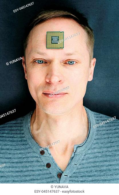 The man wiht a CPU. The processor is on the man's forehead