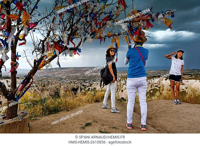 Turkey, Nevsehir, Cappadocia, Goreme, listed as World Heritage by UNESCO, Goreme National Park, votive offerings made of plastic strips hanging from a tree...