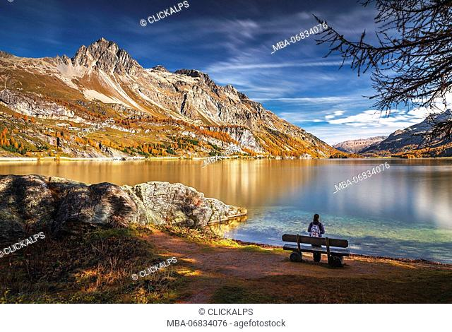 Hiker take relax admiring Lake Sils, Engadine, Canton of Graubunden, Switzerland, Europe