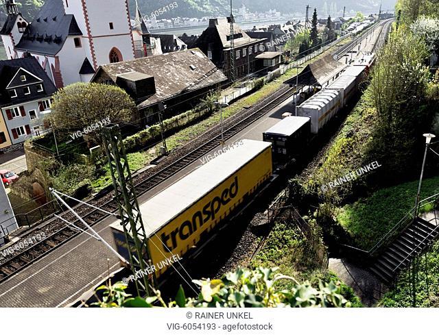 DEU , GERMANY : A cargo train of Deutsche Bahn AG is passing through St. Goar / Sankt Goar , 18.04.2018 - St. Goar, Rhineland-Palatinate, Germany, 18/04/2018