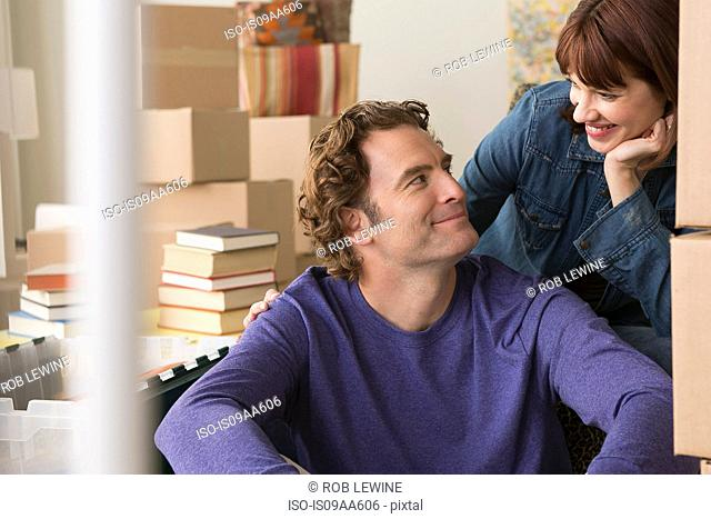 Couple surrounded by cardboard boxes