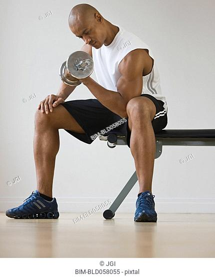 African man lifting dumbbell