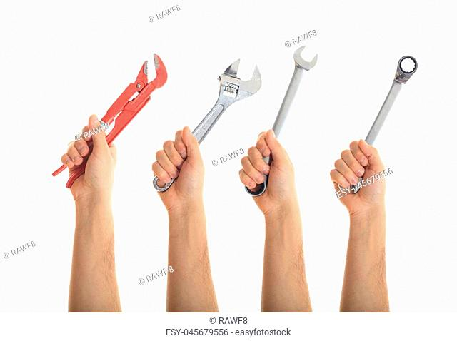 Hands holding hand tools on white background