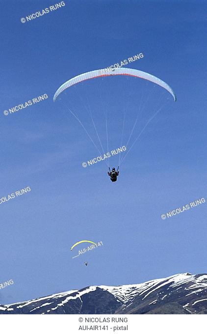 Aerian Leisure - Paraglider in the Mountain