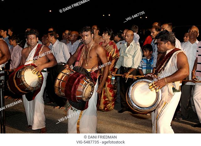CANADA, BRAMPTON, 08.08.2015, Tamil Hindu musicians playing the Thavil (a traditional drum) lead the chariot procession during the Aadivel Festival (Aadi Vel...