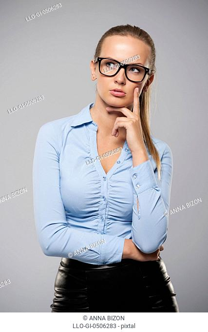 Pensive and serious businesswoman wearing fashion glasses, Debica, Poland