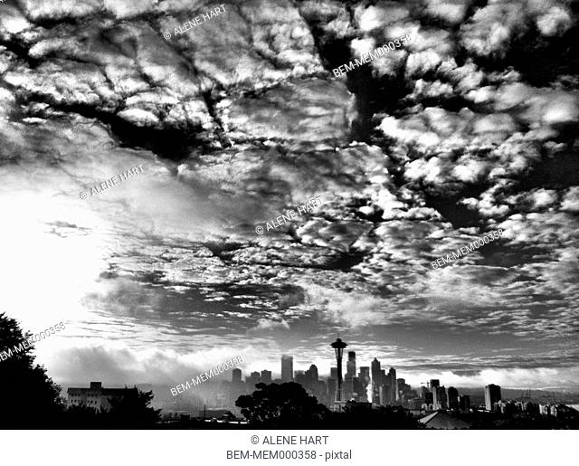 City skyline under dramatic sky, Seattle, Washington, United States
