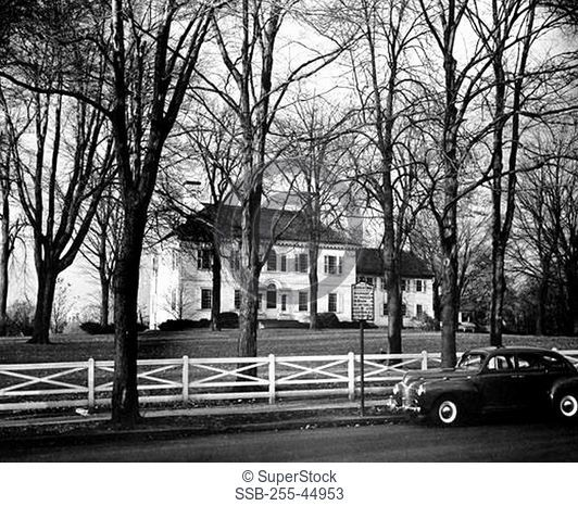 Bare trees in front of a mansion, Ford Mansion, Morristown, New Jersey, USA