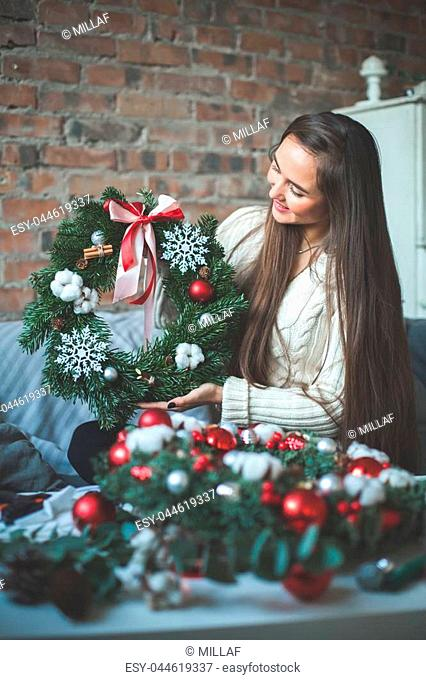 Florist Girl with Christmas Decorations Glass Balls, Evergreen Xmas Tree and Snowflakes