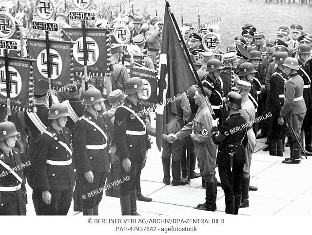 Nuremberg Rally 1937 in Nuremberg, Germany - Consecration of new standards with the 'Blood Flag' by Adolf Hitler during the roll call of Sturmabteilung (SA)