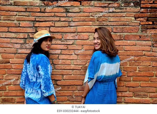 Thai women portrait at ancient building at Wat Mahathat in Ayutthaya, Thailand