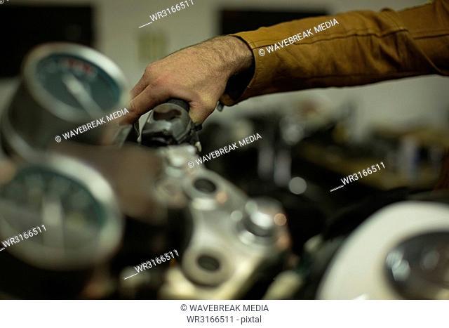 Mechanic checking a motorbike brakes