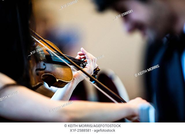 Young musicians: classical music violin players in rehearsal at Aber Music Fest festival 2015