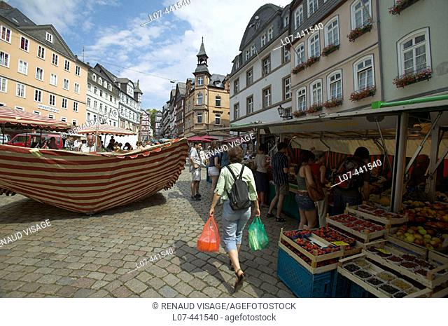 Open-air market on a pedestrian street in the historic town center. Marburg. Germany
