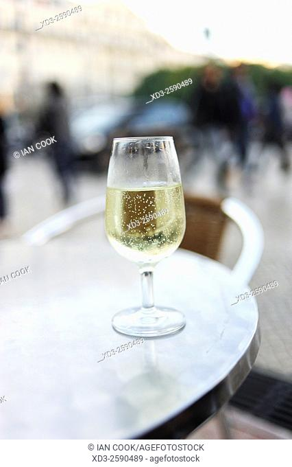 glass of white wine at a outdoor cafe, Praca da Figuera, Lisbon, Portugal