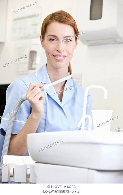A portrait of a female dental nurse/hygienist