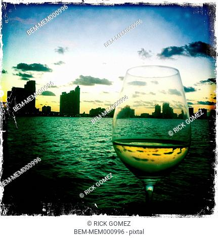 Glass of wine and urban skyline, Miami, Florida, United States