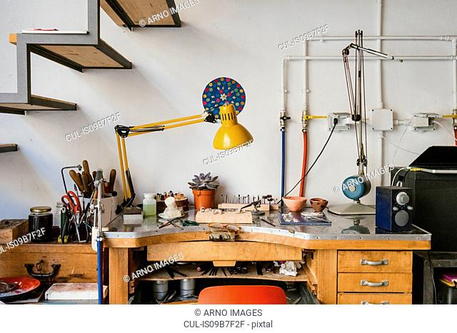 Jewellery making equipment and tools on jewellery workshop workbench