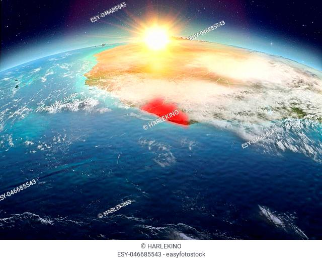 Satellite view of Liberia highlighted in red on planet Earth with clouds during sunrise. 3D illustration. Elements of this image furnished by NASA
