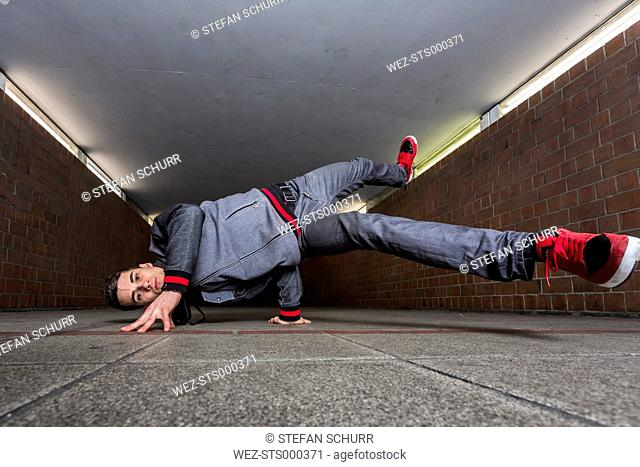 Germany, portrait of young break dancer in underpass